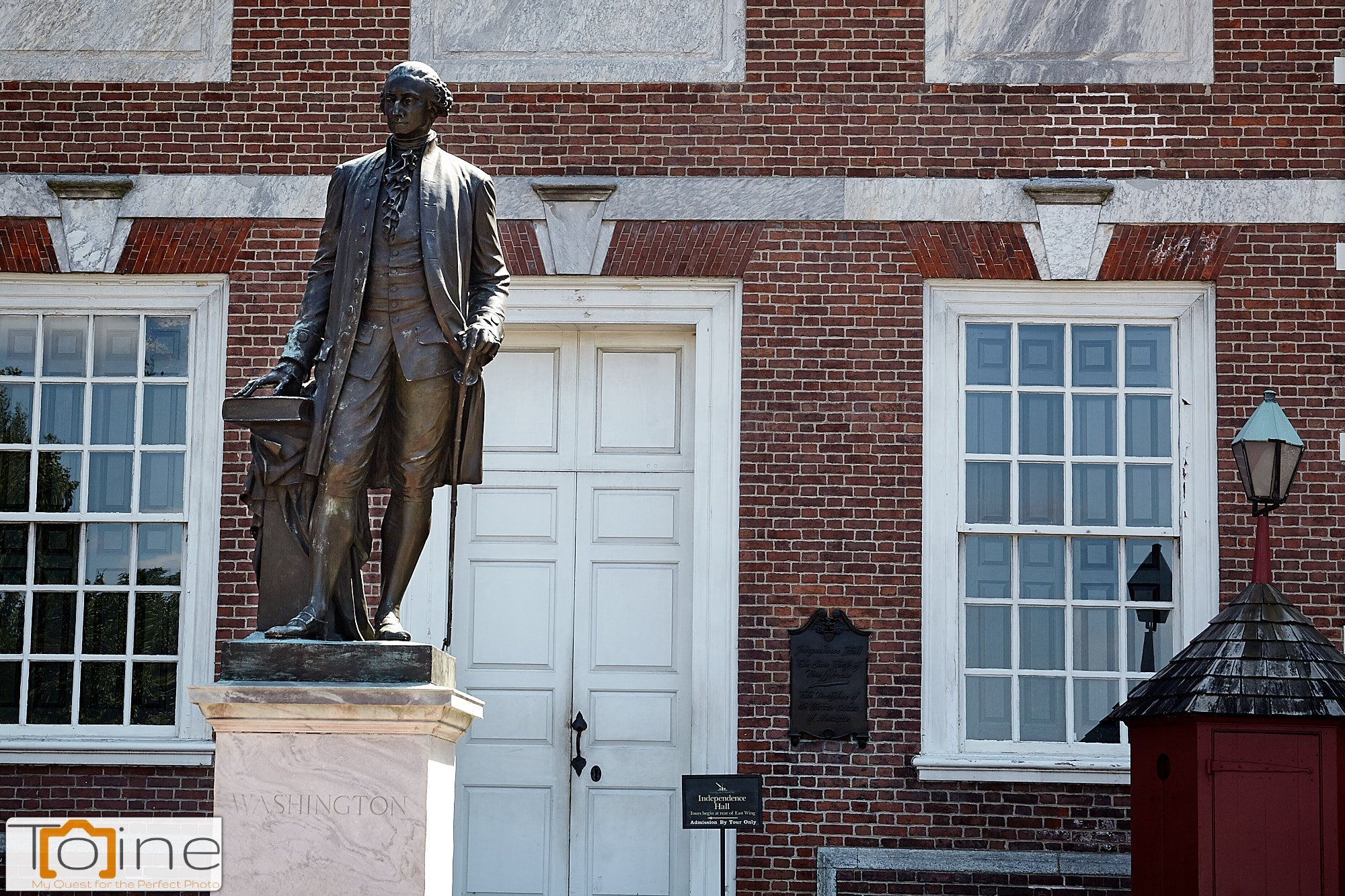 Independence Hall with a Statue of George Washington.
